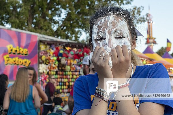 Wheat Ridge  Colorado - A high school student gets a pie in the face as a fundraiser during the annual Carnation Festival. The festival features food and entertainment. It was named for the flowers that were widely cultivated in this Denver suburb in the second half of the 20th century.