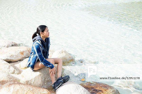 Thai girl poses for picture in Brisbane  Australia. Brisbane is one of the Australia's tourist destination points.