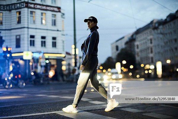 Woman walking on street in Berlin  Germany