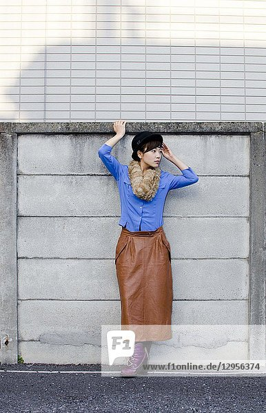 Japanese Girl poses on the street in Shimo-Kitazawa  Japan. Shimo-Kitazawa is a town located in Tokyo.