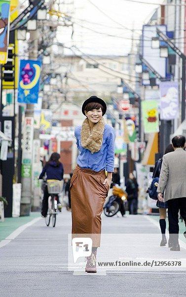 Japanese Girl poses on the street in Shimo-Kitazawa  Japan. Shimo-Kitazawa is a town located in Tokyo.
