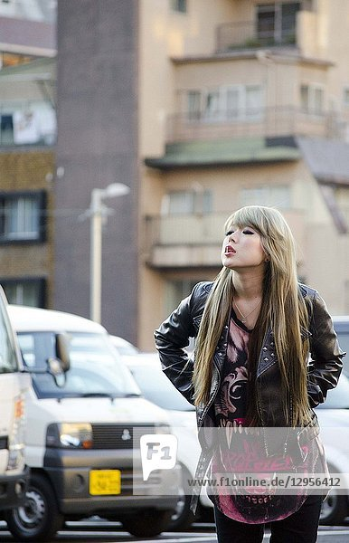 Japanese Girl poses on the street in Shibuya  Japan. Shibuya is a town which young people hang out and go shopping.