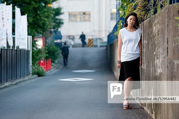 Japanese Girl poses on the street in Yokohama  Japan. Yokohama is a port city located in a bit south of Tokyo.