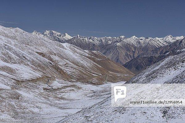 Snowbound Karakoram Mountains and the Nubra Valley seen from the Khardung La Pass  Ladakh  India.