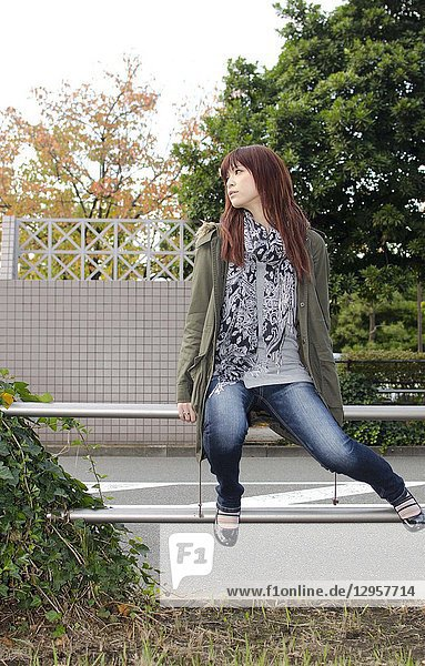 Japanese Girl poses on the street in Odaiba  Japan. Odaiba is a area by the sea in Tokyo.
