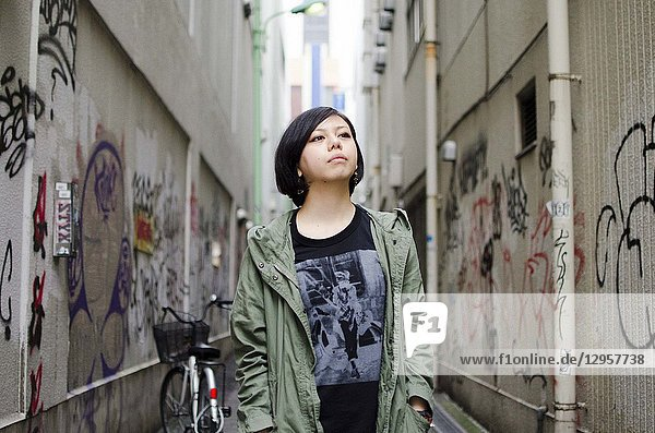 Japanese Girl poses on the street in Machida  Japan. Machida is an area located in Tokyo.