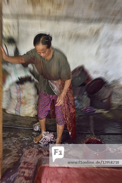 Feet fulling of cloth in the dyeing process  Kidang Mas Batik House  Lasem  Java island  Indonesia  Southeast Asia.