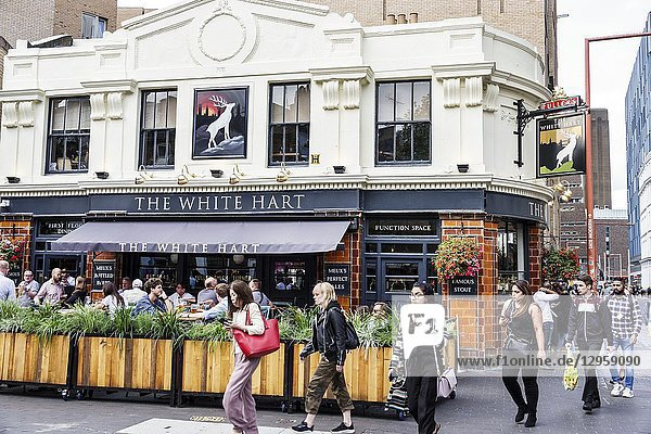 United Kingdom Great Britain England  London  Waterloo  Southwark  The White Hart  Fuller's historic pub public house  outside seating  drinking  man  woman  pedestrian  restaurant  alfresco dining