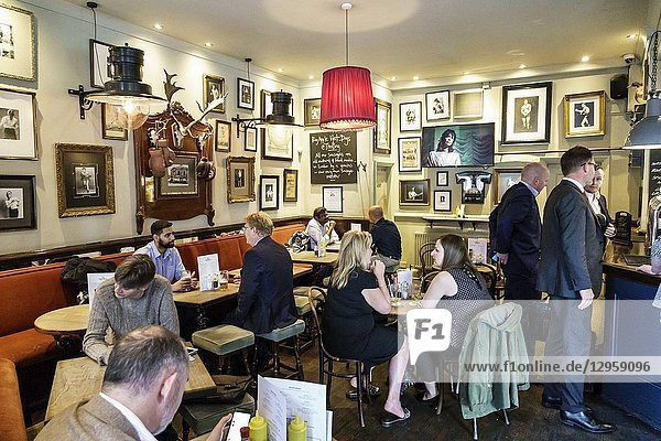 United Kingdom Great Britain England  London  Southwark  Blackfriars Rd  The Ring  historic bar public house pub  interior  barstool  drinking  beer  man  woman  after-work crowd  businessman  boxing theme photographs decor