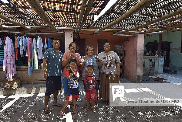 Family in their house's courtyard  Sondakan district  Solo (Surakarta)  Java island  Indonesia  Southeast Asia.