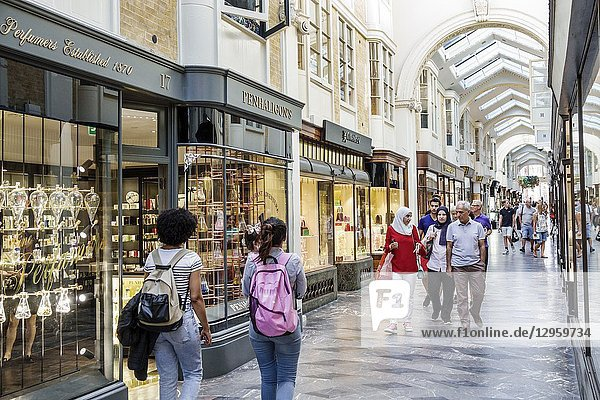 United Kingdom Great Britain England  London  Mayfair  Burlington Arcade  shopping  upmarket luxury covered pedestrian arcade  stores  Penhaligon's  perfume house  Middle Eastern  Muslim  woman  man  walking  hijab