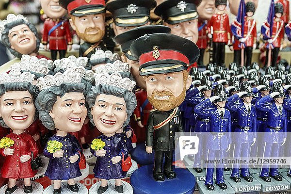 United Kingdom Great Britain England  London  Piccadilly Mayfair  shopping  souvenir shop  store  figurines  bobby on the beat  iconic images  Queen Elizabeth bubblehead  Prince Harry Bubblehead  display sale