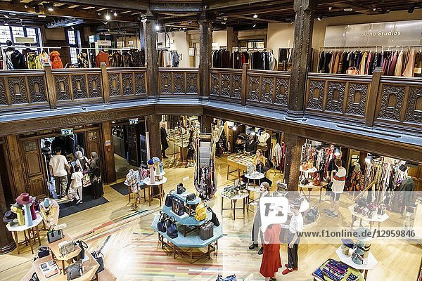 United Kingdom Great Britain England  London  Soho  Liberty Department Store  shopping  luxury brands upmarket  atrium  lightwell  Tudor revival architecture  historic building  overhead view  railings  display sale