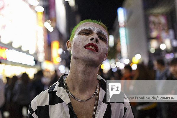 October 31  2018  Tokyo  Japan - A costumed partygoer enjoys Halloween celebrations in Shibuya. People gather to celebrate Halloween every year in Shibuya's famous scramble crossing and Roppongi area. Police presence controlling pedestrian access to avoid the risk of traffic accidents and other incidents.