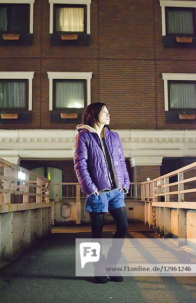 Japanese Girl poses on the street in Aoyama  Japan. Aoyama is a famous area about universities in Tokyo.