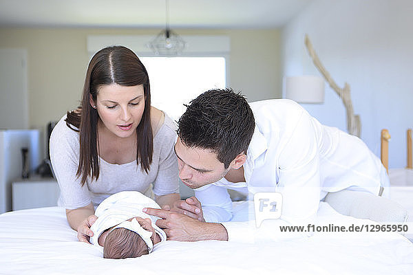 Baby with parents at home