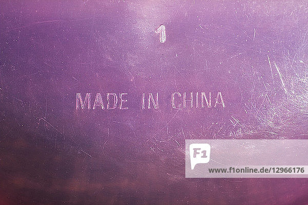 'Close-up of the bottom of a plastic container inlaid with ''Made in China'''