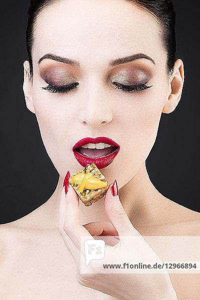 Tight shot of a girl enjoying a lemon cake