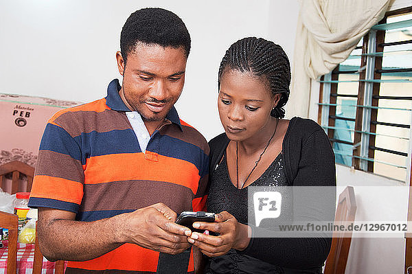 Couple looking at a smartphone