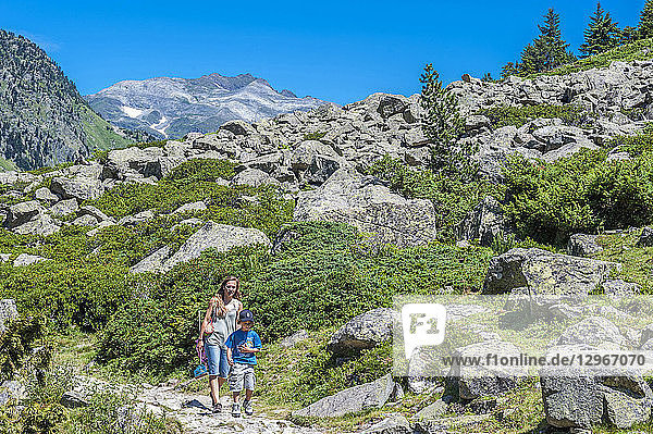 France  Pyrenees National Park  Occitanie region  Val d'Azun  6-year-old boy and his mother on a track of the valley of the gave d'Arrens (name referring to torrential rivers  in the west side of the Pyrenees)