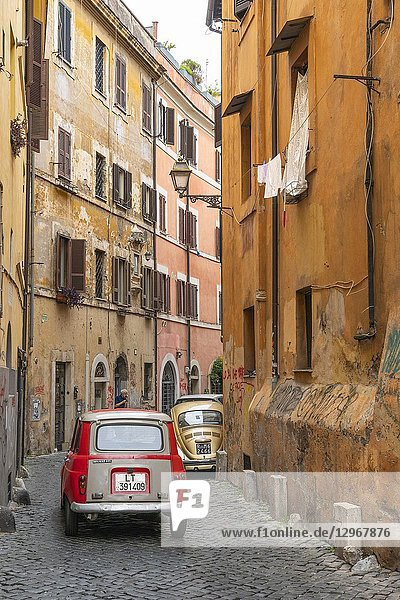 Old cars and colourful old houses in the Trastevere district of Rome  central Italy.