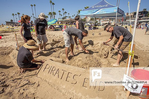 Using a 'Pirates of the Pacific' theme  sand castle builders dig in the sand at a holiday competition in Newport Beach  CA.