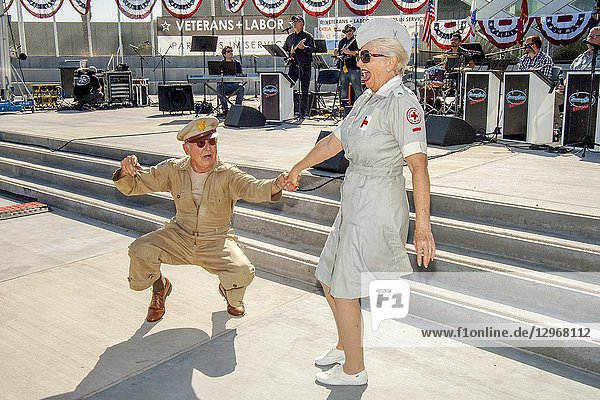 A World War II veteran in US Army uniform and a women dressed as a Red Cross volunteer happily dance the jutterbug at a Veterans Day celebration in Costa Mesa  CA.