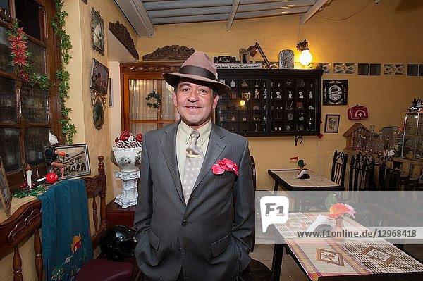 Alfredo Ortiz Huertas owner of the restaurant La Puerta Real  Bogotan traditional cuisine and vintage stuff. Bogota. Colombia.