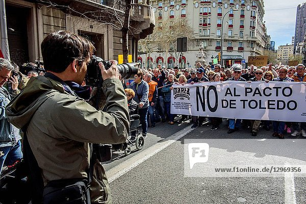 A photographer in the demonstration for fair pensions. Pensioners and young people from all around Spain took part in a nationwide demonstration to protest the government's plan to only increase their pension by 0.25%