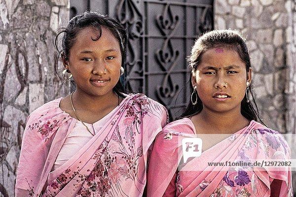 Two young affluient girls in downtown Kathmandu Nepal Katmandu
