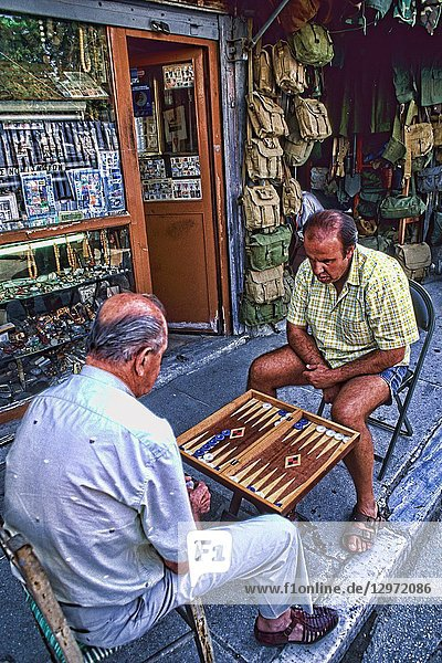 Men playing backgammon in streets in Athens Greece