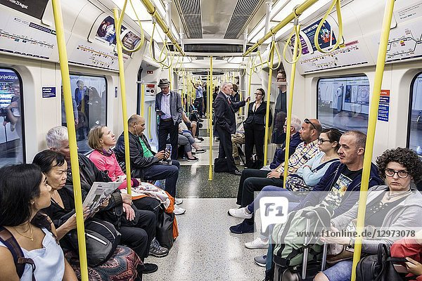 United Kingdom Great Britain England  London  Lambeth South Bank  Waterloo Underground Station  subway tube  public transportation  train  inside  carriage cabin  seats  sitting  man  woman  passenger  commuter