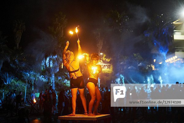 Fire dancers performing at Tribal Beach Party at Starbeach Chersonissos  Crete  Greece