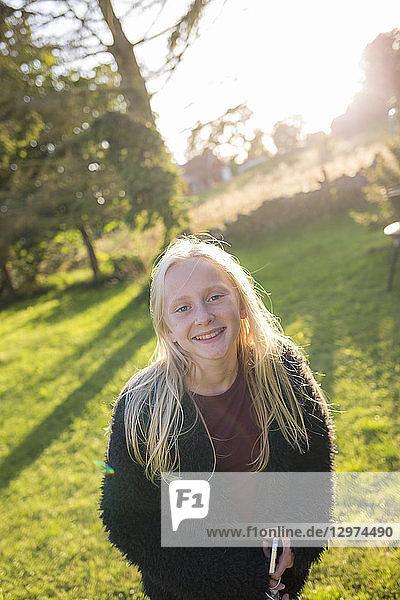 Portrait of girl in a field in Ornahusen  Sweden