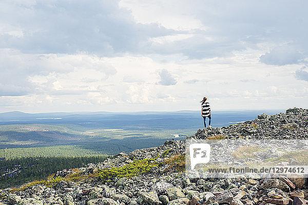 Woman standing on rocks in Kittila  Finland