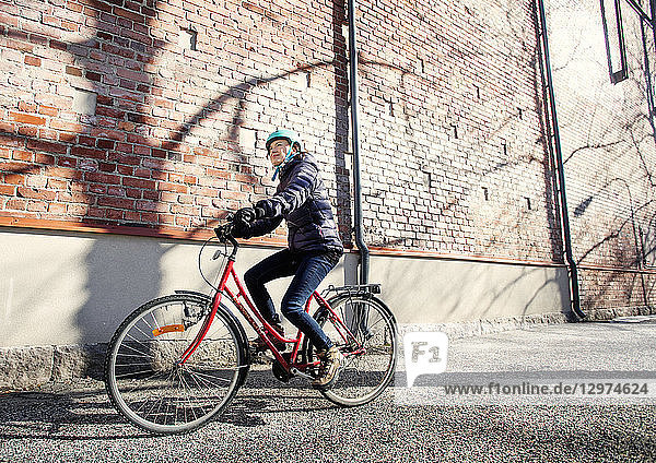 Mid adult woman riding a bicycle in Lahti  Finland