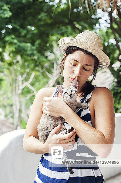 Young woman holding a kitten in Koh Tao  Thailand