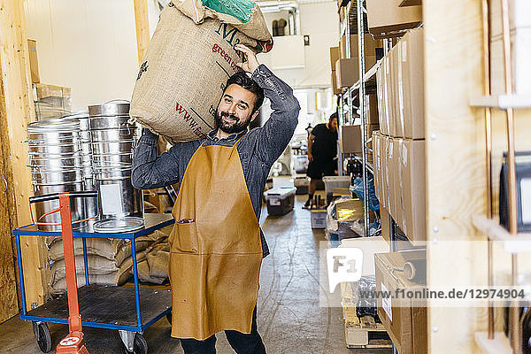 Small business owner working in his coffee roaster shop