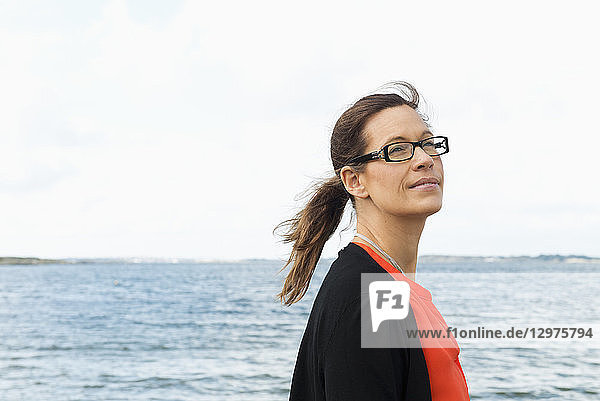 Mid adult woman by the sea