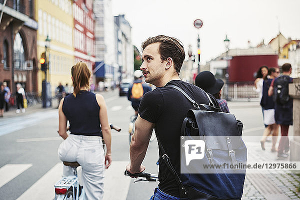 Young man riding a bicycle in Copenhagen  Denmark
