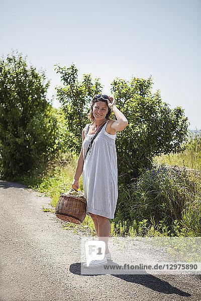 Woman with picnic basket in Blekinge  Sweden