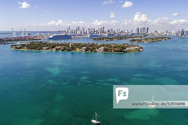 Florida  Miami Beach  Biscayne Bay  aerial overhead bird's eye view above  Star Island  Port of Miami cruise ships  city skyline  water  boats