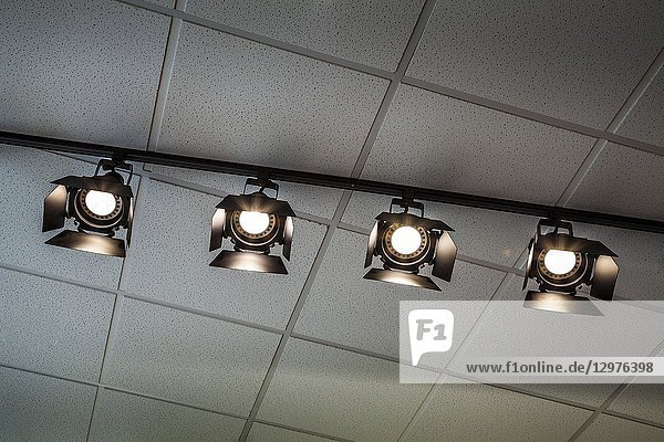 Theatrical lights hanging from the ceiling.