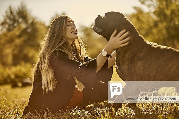 Woman with dog on meadow in Unterhaching  Munich  Bavaria  Germany.