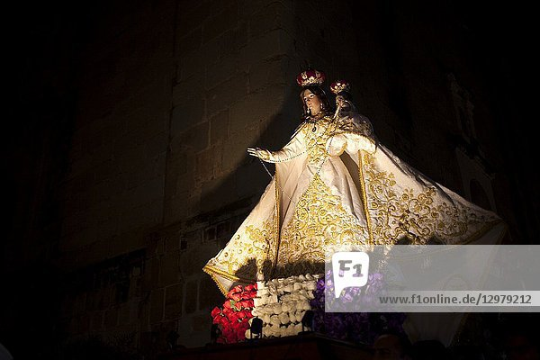 Images of the Virgin of the Rosary displayed during a religious ceremony outside the Templo of Santo Domingo Catholic church in Oaxaca  Mexico.