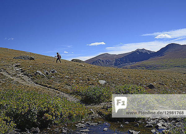 Woman hiking on Square Top Mountain in Colorado