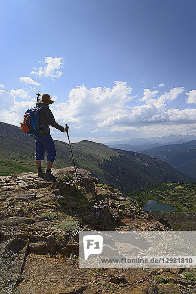 Woman admiring view while hiking on Berthoud Pass Trail in Colorado
