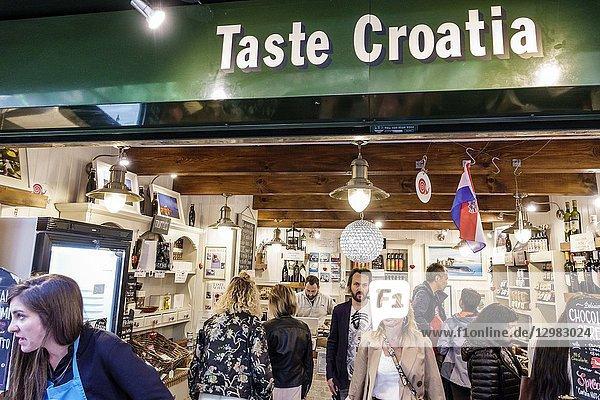 England  London  South Bank Southwark  Borough Market  vendors stalls  Taste Croatia  ethnic food store  shopping  man  woman