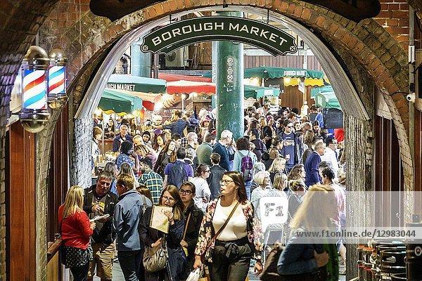 England  London  South Bank Southwark  Borough Market  vendors stalls  entrance  crowded  woman  man
