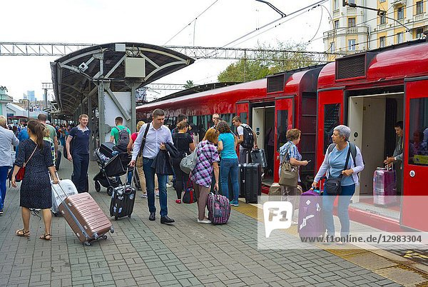 People getting off Aeroexpress  airport train  Belorussky Vokzal  Belorussian railway station  Moscow  Russia.